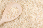 Rice in wooden spoon — Stock Photo