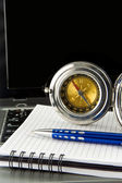 Pen and compass on notebook laptop — Foto Stock
