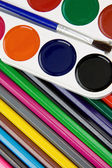 Painters palette and brush on pencils — Foto Stock