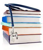 Books and stethoscope isolated on white background — Stockfoto