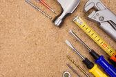 Tools and instruments on wood texture — Stock Photo