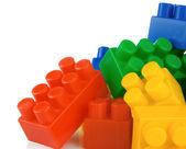 Plastic toys and bricks isolated on white — Stock Photo