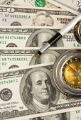 Pen and compass on dollars — Stock Photo