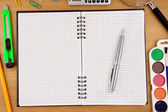 School accessories and checked notebook on table — Stock Photo