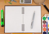 School accessories and notebook on table — Stock Photo