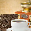 Cup of coffee and grinder with beans — Stock Photo #11893925