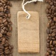 Coffee beans and tag price label on wood — Stock Photo