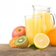 Fresh fruits and juice in glass isolated on white — Stock Photo