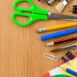 School supplies and checked notebook on wood — Stockfoto #11894067