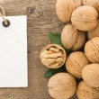 Walnuts fruit on wood background — Stock Photo