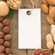 Set of nuts fruit and tag label on wood — Stock Photo