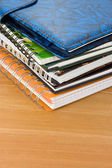 Pile of books and notebook on wood — Stock Photo