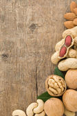 Set of nuts fruit on wood background — Stock Photo