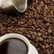 Cup of coffee and pot on beans — Stok fotoğraf