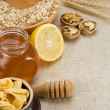 Oat, honey and healthy food on sacking - Stock Photo