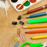 School accessories on wooden texture — Stock Photo