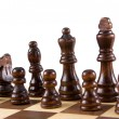 Stock Photo: Chess figures isolated on white