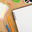 School accessories and checked notebook on wood — Stock Photo #11938196