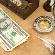 Dollars, compass and hourglass — Stock Photo