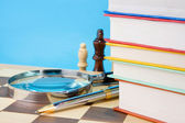 Books, pen and chess — Stock Photo
