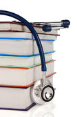 Books and stethoscope isolated on white — Stockfoto