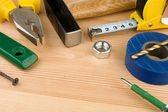Set of tools and instruments on wood — Stock Photo
