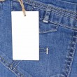 Price tag over blue jeans pocket - Stock Photo
