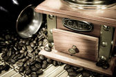 Coffee beans, pot and grinder on sack — Stock Photo