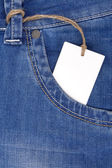 Price tag over jeans textured pocket — Stock Photo