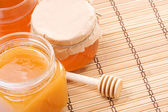 Glass pot full of honey — Stock Photo