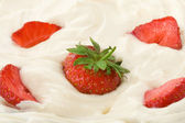 Fresh strawberry in cream — Stock Photo