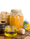 Pot of honey isolated on white — Stock Photo