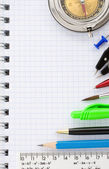 School supplies on checked background — Stock Photo