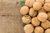 Walnuts fruit on wood background — Stock Photo