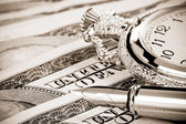 Ink pen and watch on dollar banknotes — Stock Photo