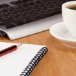 Keyboard, notebook and cup of coffee — Stock Photo