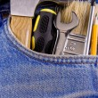 Set of tools and instruments in old jeans - Foto Stock