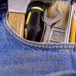 Set of tools and instruments in old jeans - Stockfoto