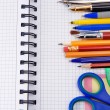 Pens, pencils and office accessories on notebook — Stok fotoğraf