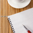Pen on notebok and cup of coffee — Stockfoto