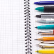 Pen, pencil and felt pen on notebook — Stock Photo