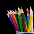 Pencils in a jar on black background — Stock Photo