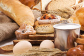 Bread, eggs, buns, grain and spike on sack — Stock Photo