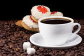 Cup and cookies on coffee beans — Stock Photo