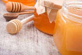 Glass jars with honey — Stock Photo
