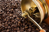 Coffee and grinder on beans — Stock Photo