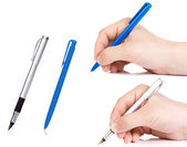Hand holding pen on white — Stock Photo