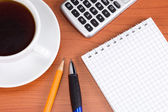 Checked notebook and cup coffee — Stockfoto