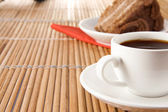 Cup of coffee and sweet pie on wood — Stock Photo