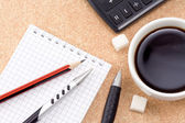 Pen, pencil, cup of coffee and notebook — Stock Photo